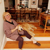 Anna Kasabian of Manchester with her faithful canine companion, Amos. Her studio is actually spread across several rooms in her house including her dining room and kitchen, behind her. Photo by Allegra Boverman.