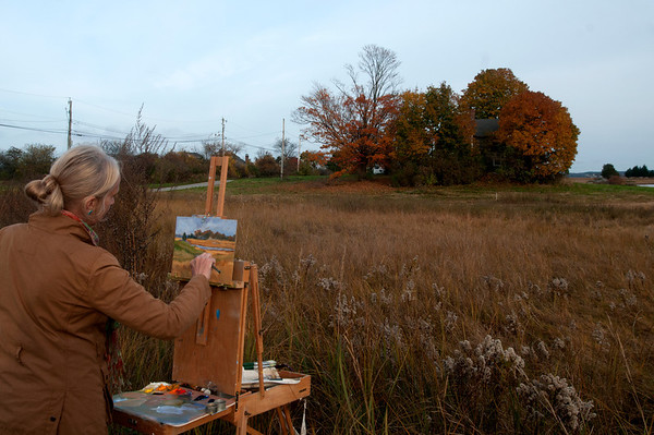 Jim Vaiknoras/Cape Ann Magazine: Colleen Kidder paints off Island Rd in Essex.