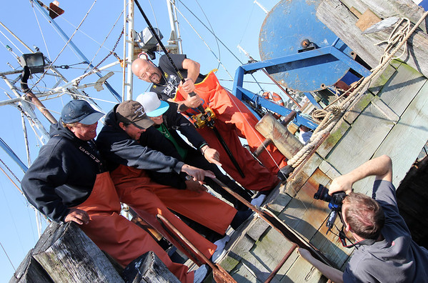 """""""Wicked Tuna"""" captains, from left, Bill Monte of the Bounty Hunter), Dave Carraro of the FV-Tuna.com, Tyler McLaughlin of the Pin Wheel, and Dave Marciano of Hard Merchandise pose for photographer Jesse Edwards of Evolve IMG.<br /> Photo by Allegra Boverman."""