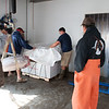 """Rick Schrafft  and xxx ready a packing crate for a bluefin tuna caught by Capt. Dave Carraro, far right, as a """"Wicked Tuna"""" cameraman films the scene for the TV series. Photo by Desi Smith."""