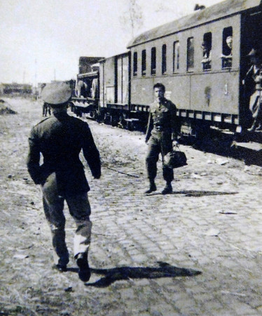 Courtesy photo<br /> Curtis Dagley, center, disembarks from a train in Krakow, Poland. Dagley was one of 12 guards on a special 27-car train traveling from Nuremberg, Germany, to Krakow, Poland, that was returning priceless art pieces stolen by the Nazis.