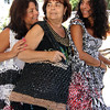 "ALLEGRA BOVERMAN/Staff photo. Gloucester Daily Times. Gloucester: Accursio ""Gus"" and Francesca Alba of Gloucester make tote bags,  purses and other accessories. Francesca, center, wears one of their tote bags adorned with metallic pieces. With other totes the couple made are their daughters Sandra Sanfilippo, left, and Dianne Jackson."
