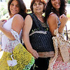 "ALLEGRA BOVERMAN photo<br />  Accursio ""Gus"" and Francesca Alba of Gloucester make tote bags, purses and other accessories. Francesca, center, wears one of their tote bags adorned with metallic pieces. With other totes the couple made are their daughters Sandra Sanfilippo, left, and Dianne Jackson."
