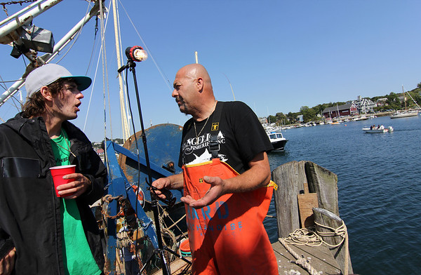 """New cast member Tyler McLaughlin, 25, of Rye, N.H., captain of the Pin Wheel, speaks with Capt. Dave Dave Marciano of the Hard Merchandise during filming of the second season of """"Wicked Tuna."""" Photo by Allegra Boverman."""
