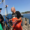 "New cast member Tyler McLaughlin, 25, of Rye, N.H., captain of the Pin Wheel, speaks with Capt. Dave Dave Marciano of the Hard Merchandise during filming of the second season of ""Wicked Tuna."" Photo by Allegra Boverman."