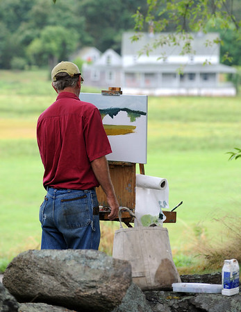 Essex: Artist John Rydynkowski paints a scene at the Cox Reservation, at the First Annual Paint Essex Day and Wet Paint Auction Saturday morning. Artist from all over came to paint scenes in and around Essex, and where later shown and auctioned off at the barn at the Cox Reservation. Over 50 artist participated, all but two paintings sold by the end of the silent auction and reception. The money raised went to the Essex Merchants Group to help make Essex a destination spot from people to visit. Desi Smith/Gloucester Daily Times. August 18, 2012.