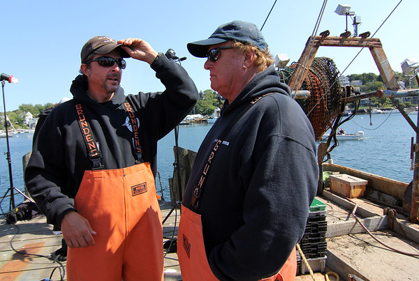 """Capts. Dave Carraro of the FV-Tuna.com and Bill Monte of the Bounty Hunter take a break during  filming of """"Wicked Tuna."""" Photo by Allegra Boverman."""