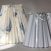 "Clever Covers. These pleated lampshade slipcovers are handmade by Ariana Barron of Rockport, and of La Provence, 4 Main Street, Rockport. They adjust to fit over an existing lampshade of any shape. Two sizes, 12 inches, $26, (left) and 9 inches, $22, (right) with adjustable width.  Also available at  <a href=""http://www.shopclevercovers.com"">http://www.shopclevercovers.com</a> Photo by Allegra Boverman."