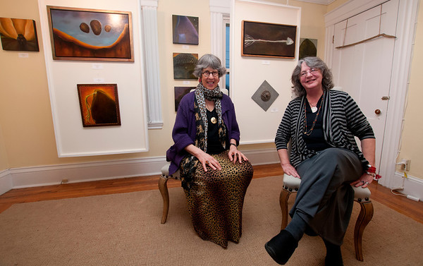 Jim Vaiknoras/Cape Ann Magazine: artists Lindley Briggs and Cameron Sesto  pose with their art at a reception at the Eventide Studio in Essex.