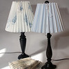 "Clever Covers. These pleated lampshade slipcovers are handmade by Ariana Barron of Rockport, and of La Provence, 4 Main Street, Rockport. They adjust to fit over an existing lampshade of any shape. Two sizes, 12 inches, $26, (left) and 9 inches, $22, (right) with adjustable width. Shade at bottom is folded. Also available at  <a href=""http://www.shopclevercovers.comPhoto"">http://www.shopclevercovers.comPhoto</a> by Allegra Boverman."