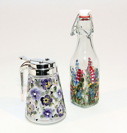 """From left: Handpainted syrup dispenser, $12, cruet, $10-$14 depending on style. Pauline's Gift Shop, 512 Essex Ave., Gloucester. 978-281-5558  <a href=""""http://www.paulinesgiftshop.com"""">http://www.paulinesgiftshop.com</a> Photo by Allegra Boverman."""