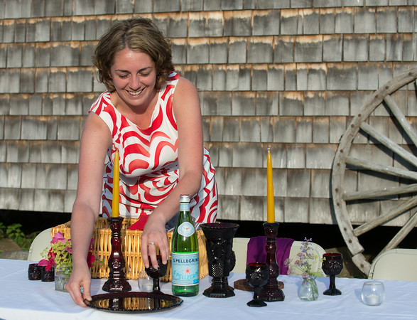 DESI SMITH/Staff photo.    Joanne Chiriro, sets her space at a table shared by others, at a dinner in color a benefit for Windhover in Rockport.