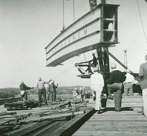 Gloucester Daily Times file photo<br /> Workers guide a piece of the span into place as the A. Piatt Andrew Bridge is built over the Annisquam River in Gloucester in 1950. The bridge was completed in nine months, before the stretch of Route 128 from Beverly to Gloucester was even completed.