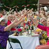"DESI SMITH/Staff photo<br /> A largre group of people, including Gail Sarofeen, right, rise their glasses as they celebrate ""Diner en Couleur,"" a benefit for Windhover Center for the Performing Arts in Rockport. They all brought a picnic meal. A prosecco toast and dance montages from 40 Steps Dance and Sarah Slifer Swift Dance were included in the $25 admission donation."