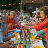 "A large group of people, including Gail Sarofeen, right, rise their glasses as they celebrate ""Diner en Couleur,"" a benefit for Windhover Center for the Performing Arts in Rockport. They all brought a picnic meal. A prosecco toast and dance montages from 40 Steps Dance and Sarah Slifer Swift Dance were included in the $25 admission donation."