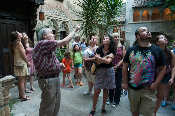 DESI SMITH/Staff photo. <br /> John Petibone, left,  points out features in the castle's cloister during an tour at Hammond Castle.