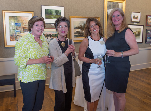 Desi Smith/Cape Ann magazine. Posing for a portrait, from left, are Susanne Lowrie Hudacs; Carol Linsky, executive director of the Rockport Art Association; Rosalie Sidoti-Iacono, North Shore Art Association trustee; and Jennifer Orlando, marking directorat the Cape Ann Saving Bank.