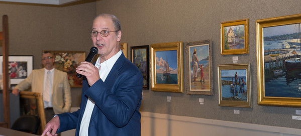 Auctioneer Michael March starts the appraisal presentation at the Appraise for Art event sponsored by Cape Ann Savings Bank in collaboration with the North Shore Arts Association and held there on Friday  June 14th, as NSAA preident Ken Knowles rear, left, looks on.    Desi Smith Photo