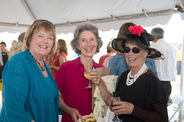 "From left to right Sara Stotzer, Joan Bowker and Susan Frey, who helped stage the cabaret event, all enjoy a glass of wine before the celebration of the centenary of the late Gloucester poet laureate Vincent Ferrini on which would have been his 100th Birthday, held on Saturday evening June 22nd in an event dubbed a ""Poet's Cabaret."" held behind the Gloucester Maritime Museum on Harbor Loop.   Desi Smith Photo"