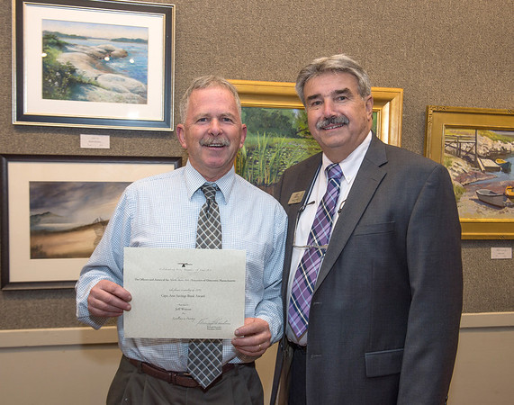 Artist Jeff Weaver holds the Cape Ann Savings Bank Award for Excellence in Painting, presented to him by bank president Bucky Rogers at the Appraise for Art event sponsored by Cape Ann Savings Bank in collaboration with the North Shore Arts Association and held there on Friday  June 14th.    Desi Smith Photo