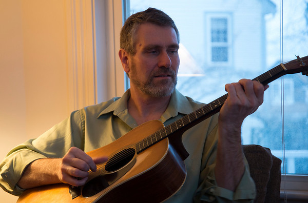 Jim Vaiknoras/Cape Ann Magazine. John Rockwell of Rockport at home with his guitar he's been playing since his youth.