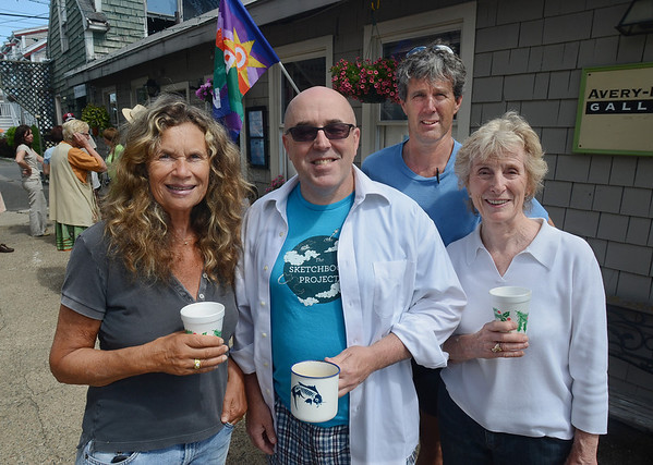 From left, Amy Ross, Stevie Black, Adam Bolonsky and Ann McKay enjoy a social hour that also included the 2nd Biennial Deviled Egg Competition Sunday, June 9 at the Khan Studio and Good Morning Gloucester Gallery on Rocky Neck Avenue in Gloucester. (Photo by Mike Springer)