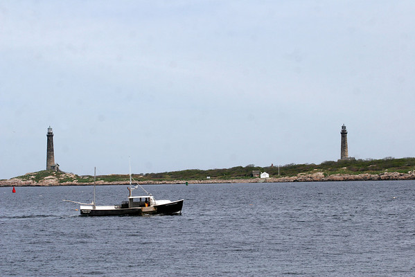 Rockport: The New Englander passes by Thacher Island while checking on lobster traps earlier this week. Photo by Kate Glass/Gloucester Daily