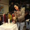 ALLEGRA BOVERMAN/Staff photo. Cape Ann Magazine. Gloucester: loucester: Elda Rodriguez, a graduate of the Wellspring House Adult Learning Initiative Program, lights a candle as she receives her certificate during the program's graduation ceremony on Wednesday evening.