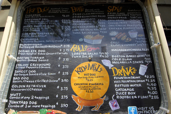 The many cleverly named hot dogs and other foods available at Top Dog of Rockport. Photo by Allegra Boverman.