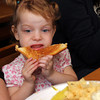 Molly Pietal, 1, of Ipswich, enjoying her grilled cheese sandwich at Woodman's. Photo by Allegra Boverman.