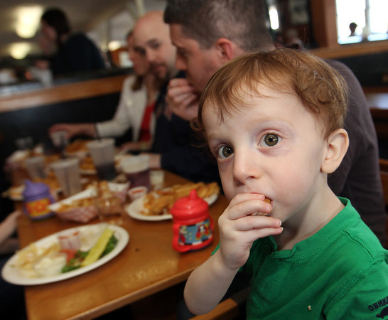 Miles Pietal, 1, enjoying his lunch at Woodman's with his family and friends. Photo by Allegra Boverman.