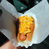 "Top Dog's ""Golden Retriever"" hot dog, popular with kids. It is a hot dog covered in macaroni and cheese. Held by Charlie MacDowell, a sixth grader from Rockport in front of the Bearskin Neck eatery. Photo by Allegra Boverman."