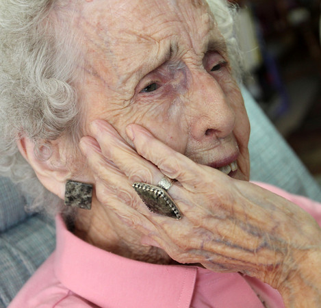 Barbara Erkkila at home in Gloucester. Her granite jewelery is made by her daughter. Photo by Allegra Boverman
