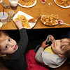 Emma Pietal, 3, lower left, and Chloe Pecci, 2, at lunch at Woodman's. Photo by Allegra Boverman.