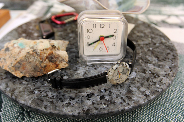 Even Barbara Erkkila's watch is made of granite, resting on a granite lazy suzan. Photo by Allegra Boverman