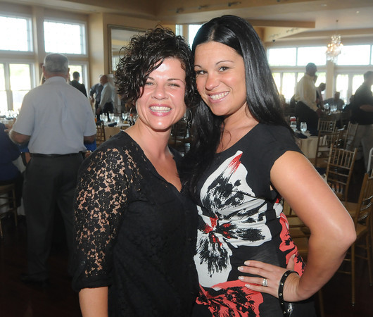 Toni Nicastro and Lindsay Moran at the retirment party for Gloucester Interim Police Chief Michael Lane  at the Cruiseport in Gloucester Wednesday night. JIm Vaiknoras/staff photo
