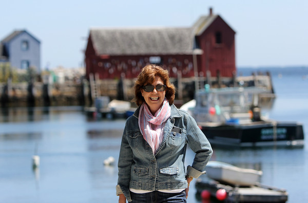 Karen Berger, chair of the town-owned art committee, who led the effort to achieve the cultural district designation in Rockport. Motif #1 is behind her. Photo by Allegra Boverman.