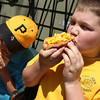 "Top Dog's ""Golden Retriever"" hot dog, popular with kids. It is enjoyed heartily by regular customers Curtis Welcome, left, a seventh grader, and his friend Charlie MacDowell, a sixth grader, both from Rockport in front of the Bearskin Neck eatery. Photo by Allegra Boverman."