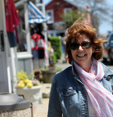 Karen Berger, chair of the town-owned art committee, who led the effort to achieve the cultural district designation in Rockport. She is walking in Bearskin Neck within the cultural district. Photo by Allegra Boverman.