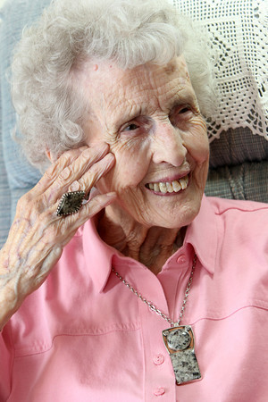 Barbara Erkkila at home in Gloucester.  Her granite jewelry was made by her daughter. Photo by Allegra Boverman