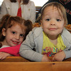 Emma Pietal, 3, left, and Chloe Pecci, 2, at lunch at Woodman's. Photo by Allegra Boverman.