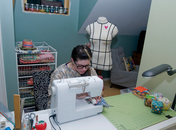 Amanda Thurston of Rockport is at work on one of her soft pillow blocks at her sewing machine. Founder of Pink Armor by Amanda, she can create anything out of her sewing machine, material and thread.<br /> Photo by Jim Vaiknoras.