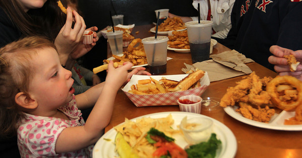 Molly Pietal, 1, enjoys her lunch with family and friends at Woodman's. Photo by Allegra Boverman.