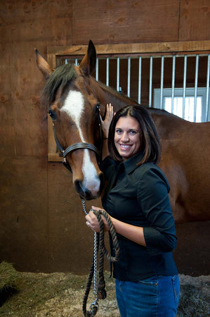 Dr. Angelique Barbara stands with Sonny inside a stall in West Gloucester. The horse is owned by Randi Kirvan.     Desi Smith Photo