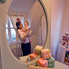 Megan Currier of Rockport, and baby Raegan stand in the baby's room where nearly all her accessories are custom-made by Rockport's Amanda Thurston. <br /> <br /> Photo by Jim Vaiknoras.