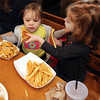 Chloe Pecci, left, 2, and Emma Pietal, 3, enjoying each other's company and lunch at Woodman's. Photo by Allegra Boverman.