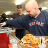Brian Pecci, front, and Matt Pietal get condiments for the table as they pick up their lunches. Photo by Allegra Boverman.