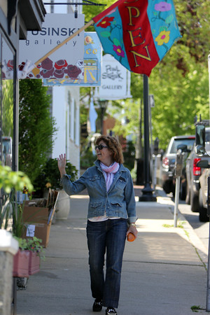 Karen Berger, chair of the town-owned art committee, who led the effort to achieve the cultural district designation in Rockport. She is walking downtown within the cultural district. Photo by Allegra Boverman.