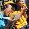 "Top Dog's ""Golden Retriever"" hot dog, popular with kids. It is enjoyed heartily by regular customers Curtis Welcome, left, a seventh grader, and his friend Charlie MacDowell, a sicth grader, both from Rockport in front of the Bearskin Neck eatery. Photo by Allegra Boverman."