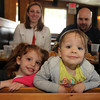 Emma Pietal, 3, lower left, and Chloe Pecci, 2, with Alexandra and Brian Pecci behind, at lunch at Woodman's. Photo by Allegra Boverman.